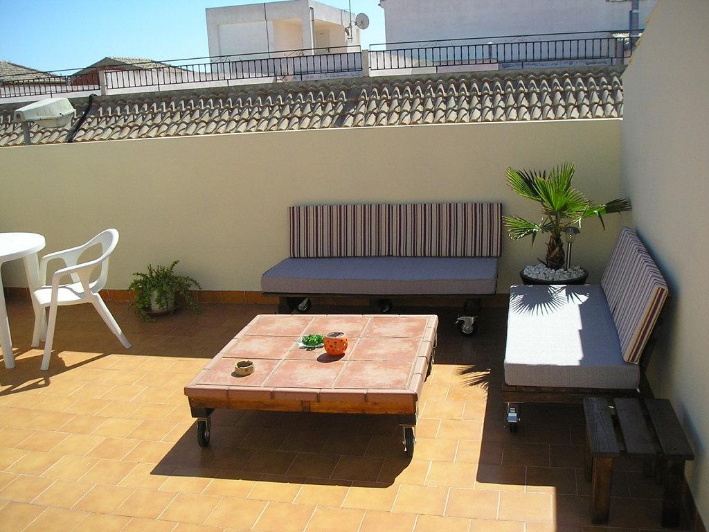 Mesas sillas y camas de pallet taringa for Muebles terraza palets
